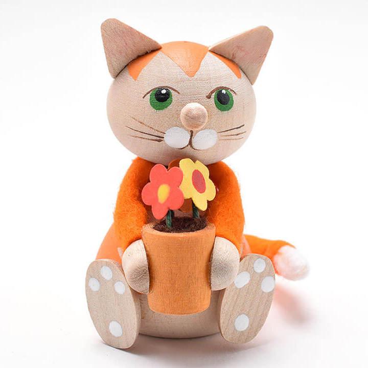 フラワーポットを抱えたお座りネコ(オレンジ)